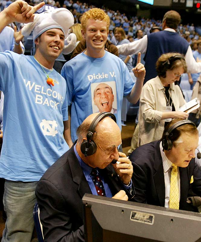 Dick Vitale ignores his fan club to concentrate on the game.