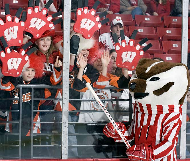 Bucky Badger interacts with fans prior to the Wisconsin-St. Cloud State matchup at the Kohl Center.