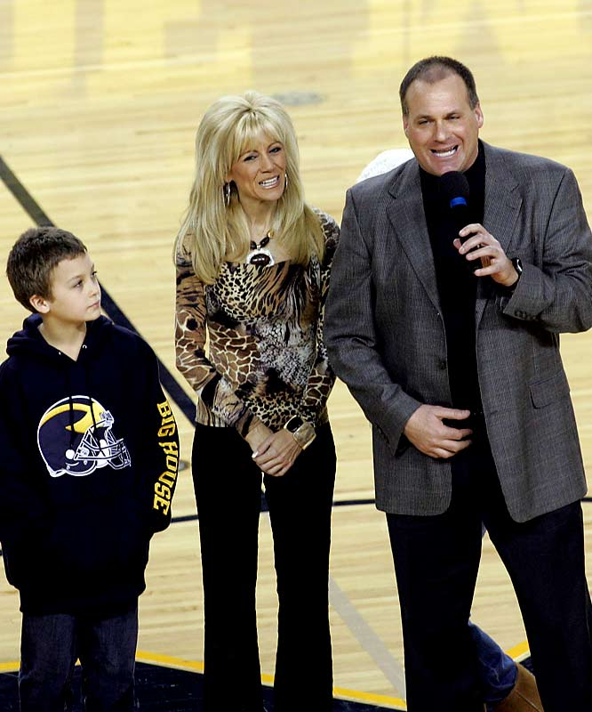 Michigan head coach Rich Rodriguez (with wife, Rita, and son, Rhett) speak  to the Michigan fans before Sunday's Wolverines-Buckeyes game.