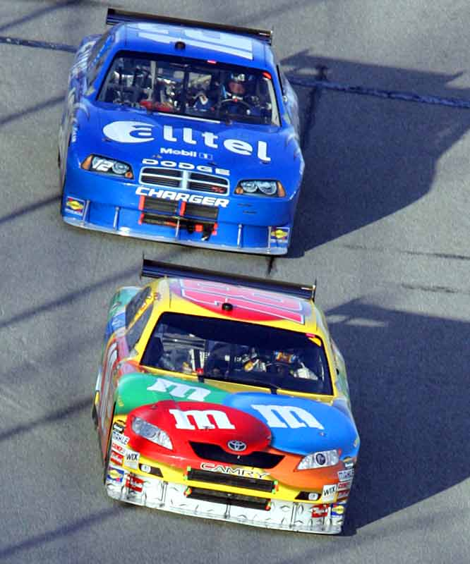 Kyle Busch, who finished fourth, enjoys a brief advantage over eventual champion Ryan Newman at Lap 100.