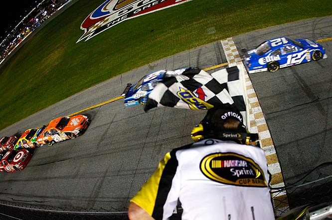 Ryan Newman crosses the finish line milli-seconds ahead of Kurt Busch in a race in which six of the top eight finishers were in Dodges.