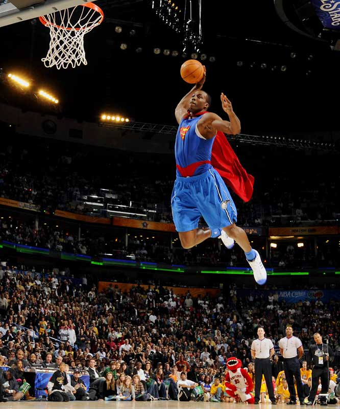 Howard donned a Superman shirt and cape, got a running start from near midcourt and went airborne just inside the free-throw line.