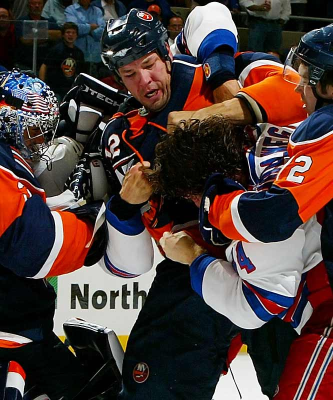 Minnesota acquired enforcer Chris Simon from the Islanders for a sixth-round draft pick.  Apparently the mauling they suffered last spring at the hands of the Ducks hasn't been forgotten. With Derek Boogaard, Todd Fedoruk and now Simon patrolling the wings, the Wild now have a goon squad capable of defending the honor of their more timid teammates...if not actually of playing hockey.