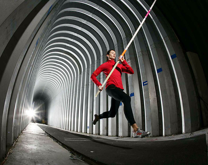 The 4,000-square-foot pole vaulting training site built by coach Rick Suhr, pins two Quonset huts end-to-end to create a 120-foot-long synthetic runway for Jenn Stuczynski (pictured) and others.