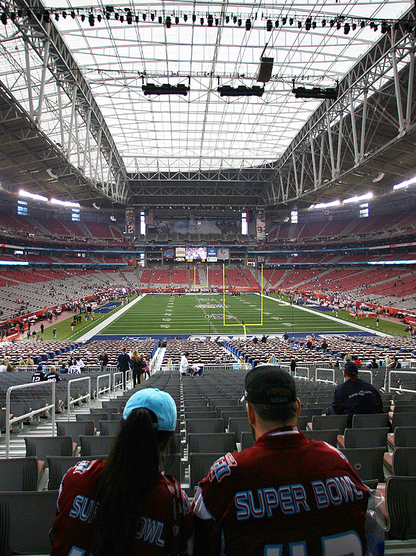 Wondering whether the weather will cooperate and allow an open roof, fans await Super Bowl XLII at University of Phoenix Stadium.