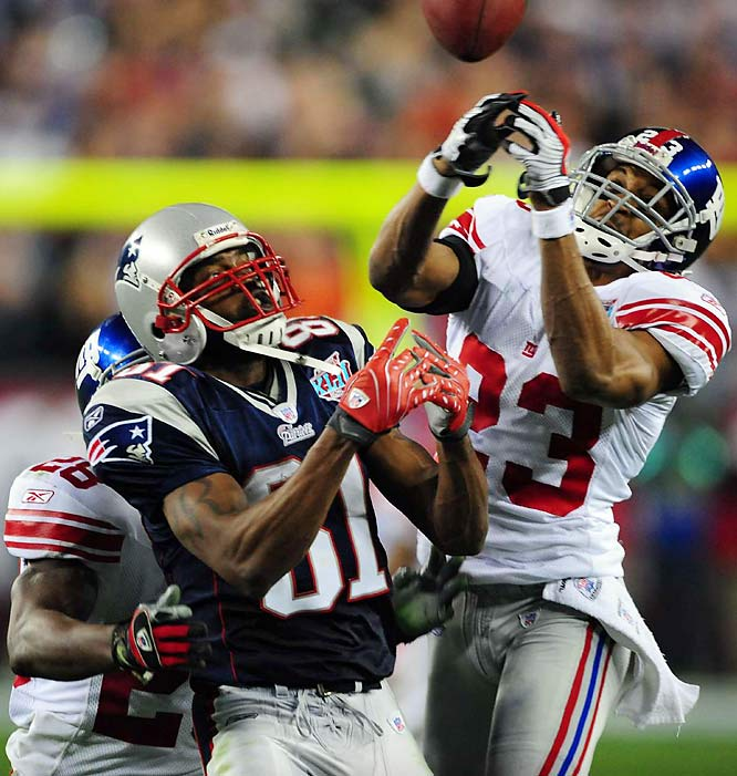 The Patriots got the ball back with 29 seconds to go, and Brady tried twice to connect with Moss on desperation throws. The first was broken up by Giants cornerback Corey Webster (23), and the second, on the Patriots' last play of the game, fell incomplete.