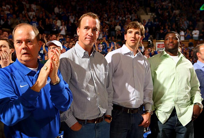 Eli and Peyton Manning make an appearance at Cameron Indoor Stadium for the Duke-UNC game.