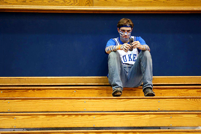 A lone Duke fan soaks in the Blue Devils loss.