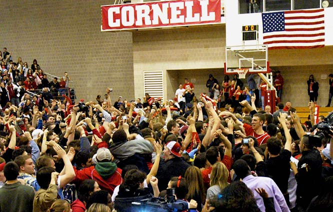 Cornell fans storm the court after the Big Red defeated Harvard, 86-53, to clinch the Ivy League title.