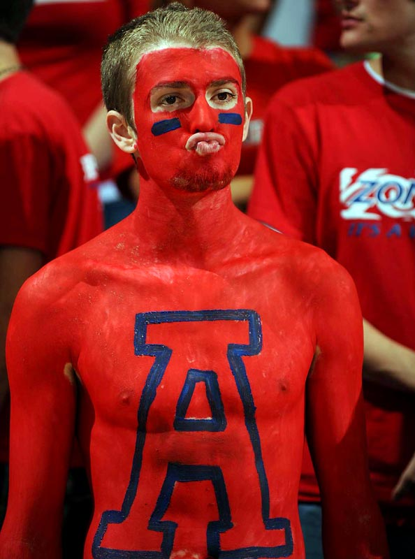 Tough luck for this Arizona fan, who not only had to watch his Wildcats lose a nailbiter to UCLA, but now has to spend the rest of the night washing off his red body paint.