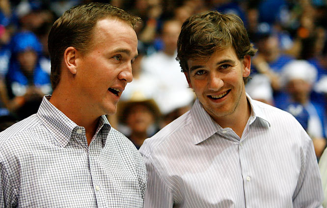 The life of a newly crowned Super Bowl champ. Eli Manning, with brother Peyton, took in the North Carolina-Duke game on Saturday...