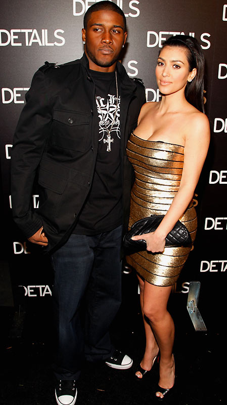 By the look on Reggie Bush's face, he doesn't seem to like having his picture taken. As long as he's with Kim Kardashian, he'd better get used to it.