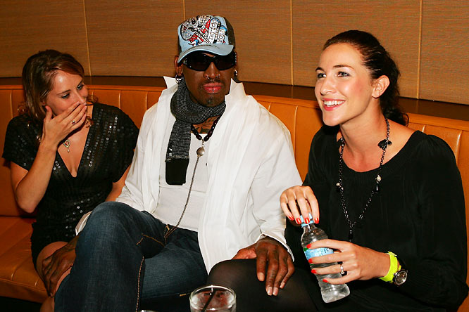 There's never a dull moment with Dennis Rodman, who spent time with Australian gymnast and diver Alexandra Croak (left) and ex-swimmer Elka Graham at the Battle of the Codes poker game held in Sydney, Australia on Thursday.