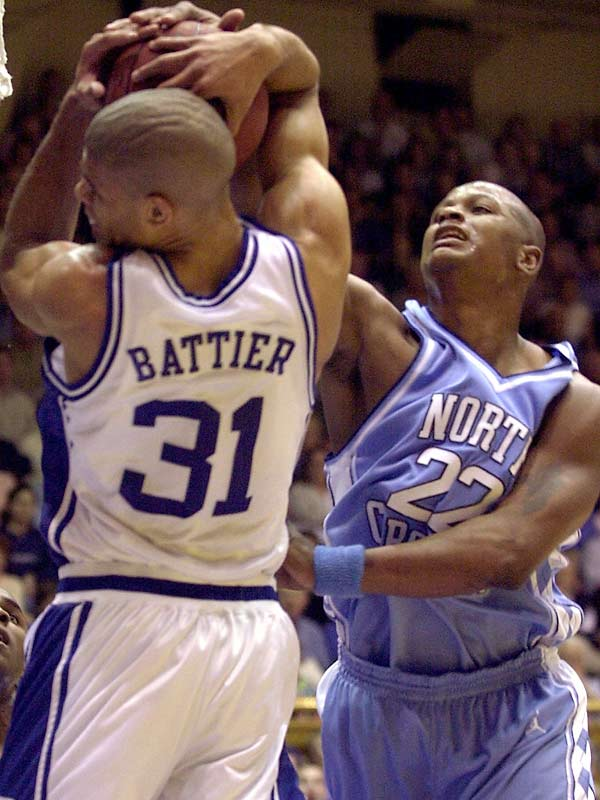 The Tar Heels win new head coach Matt Doherty's first game against Duke despite surrendering a seven-point lead in the last 90 seconds. Duke's national POY Shane Battier fouls Brendan Haywood with 1.2 seconds left and the score tied. Haywood makes both free throws and Chris Duhon's halfcourt heave hits the back of the rim at the horn.