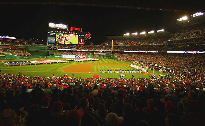 Fans rise for the National Anthem in Nationals Park, which has a seating capacity of  41,888.