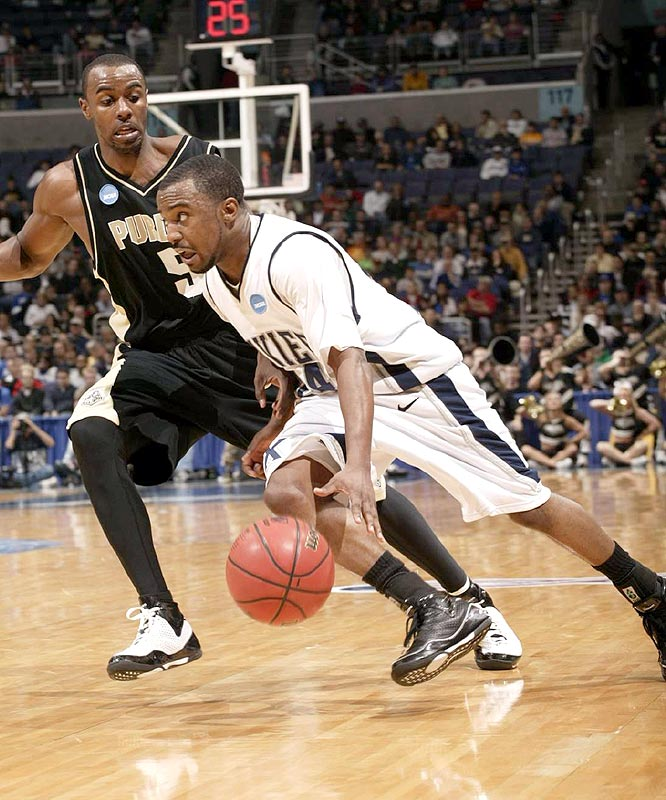 Drew Lavender (right) scored 18 points as the Musketeers advanced to the Sweet 16 for the first time since 2004.
