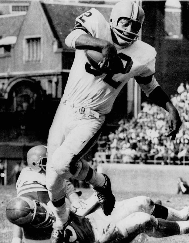 After collecting All-America honors in football and lacrosse at Syracuse, the bruising fullback made nine Pro Bowls in nine years with the Browns before his abrupt 1966 retirement. Brown retired with NFL records for single-season and career rushing yards.