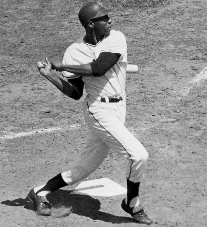 Ralph Terry, the goat of the 1960 Game 7 loss to the Pirates, was on the mound again in the ninth but this time he came out a winner as Giants slugger Willie McCovey (left) lined out to to second baseman Bobby Richardson for the final out.