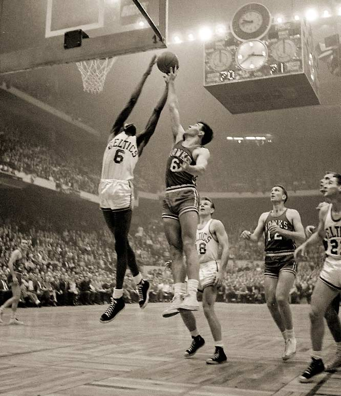 Led by a rookie center out of San Francisco named Bill Russell and his 19 points and 32 rebounds, the Celtics fought off the St. Louis Hawks in double overtime for their first NBA crown. Helping Russell was fellow rookie Tom Heinsohn with 37 points and 23 rebounds, which offset a combined 5-for-40 shooting performance by Boston stars Bob Cousy and Bill Sharman.