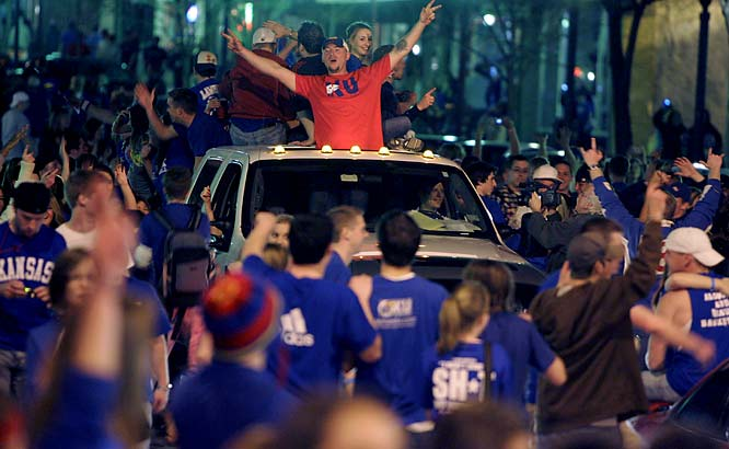 Kansas fans take to the streets of downtown Lawrence Saturday night after the Jayhawks advanced to the national title game.