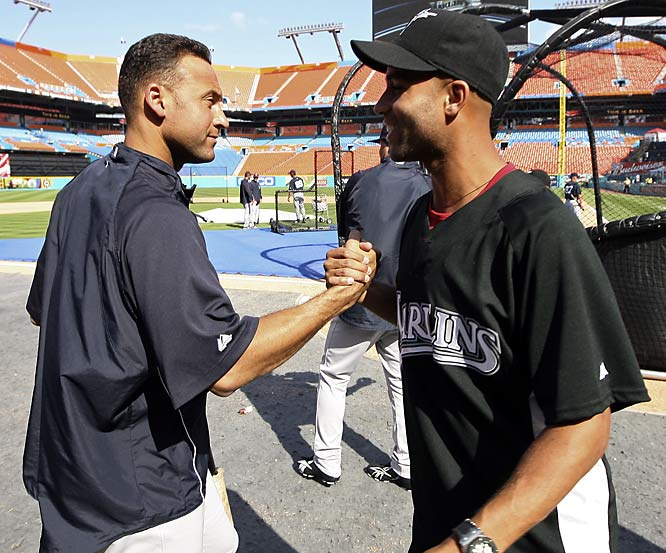Derek Jeter overlooks James Blake's choice of jersey and greets the tennis player before a spring training game at Dolphin Stadium last Saturday.