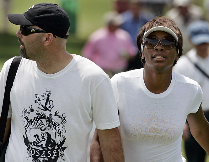 Is it just us, or does Venus Williams, shown here at the Masters with boyfriend Hank Kuehne, look a lot like Whitney Houston these days?