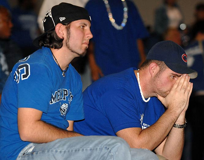 But things are much worse for the Memphis fan on the right. He's also a Cubs fan. And isn't dating Jessica Biel.