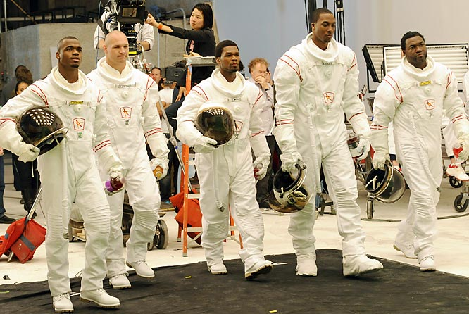The things people will do for an endorsement. Adrian Peterson, Brian Urlacher, rapper 50 Cent, Dwight Howard and David Ortiz don space suits for an upcoming Vitaminwater ad.