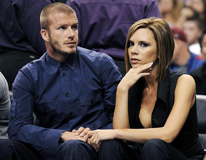 Victoria Beckham flashes her usual unhappy face for the cameras while at Thursday's Lakers-Clippers game.