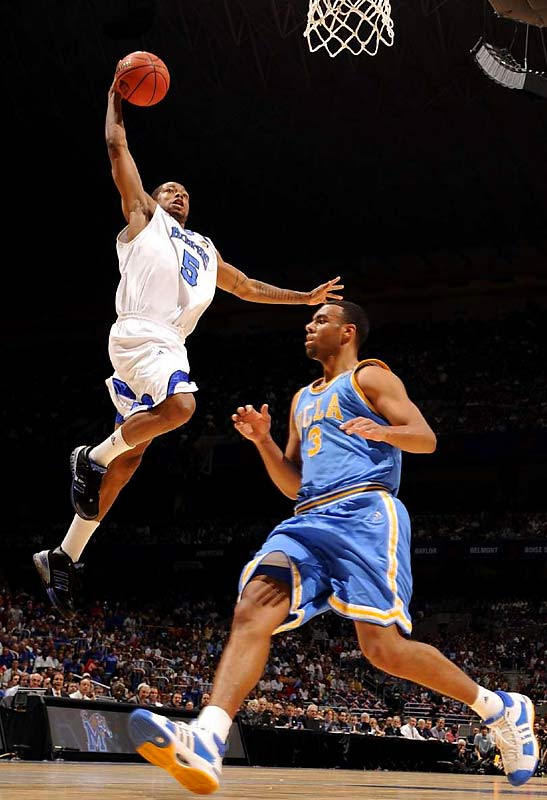 Memphis guard Antonio Anderson goes up for a dunk over UCLA's Josh Shipp during a fast-paced first half.