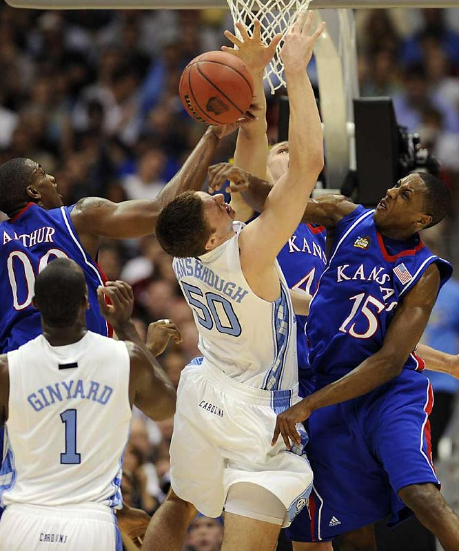 "As tenacious as Tyler ""Psycho T"" Hansbrough may be, he couldn't do (or see) much against Mario Chalmers (15) and Darrell Arthur (00), who pounced the Tar Heel star inside -- literally."