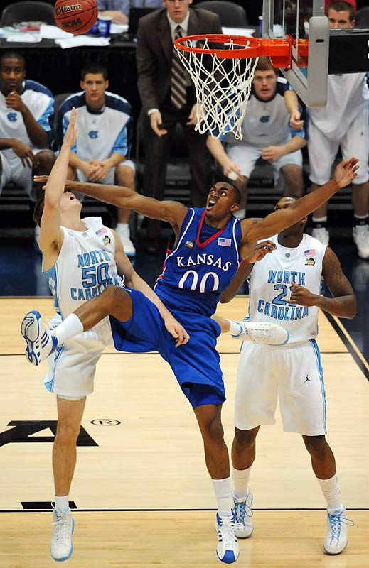 Despite Darrell Arthur's (00) four of the Jayhawks nine blocks inside, Tyler Hansbrough helped bring the Tar Heels back within five in the second half.