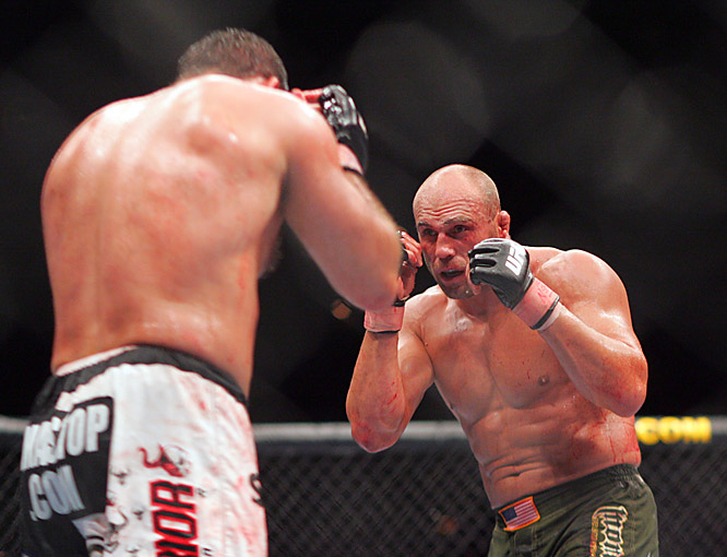 After suffering a couple of broken bones on each side of the cage, Couture, right, came away victorious at UFC 74 in August 2007, defeating Gonzaga in the heavyweight championship bout to retain the title. Couture is the only five-time UFC champ.