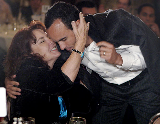 """Los Angeles Galaxy soccer star Landon Donovan embraces his mother, Donna Kenney-Cash, after he was named the """"Honda Player of the Year"""" last year."""