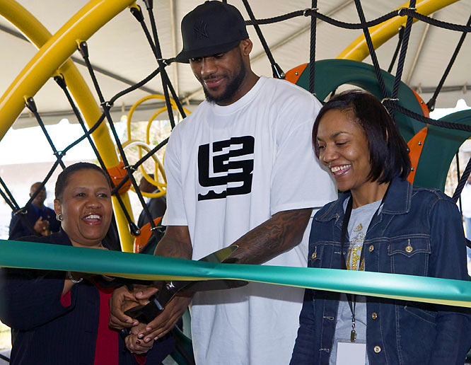 """LeBron James and his mother, Gloria James, attend a playground dedication given in part by his """"LeBron James Family Foundation"""" earlier this year."""