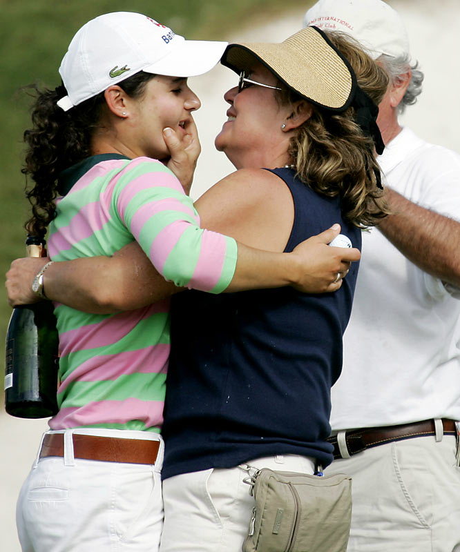 Golfing phenom Lorena Ochoa and her mother, Marcela Reyes, hug after the star won the 2007 ADT Championship.