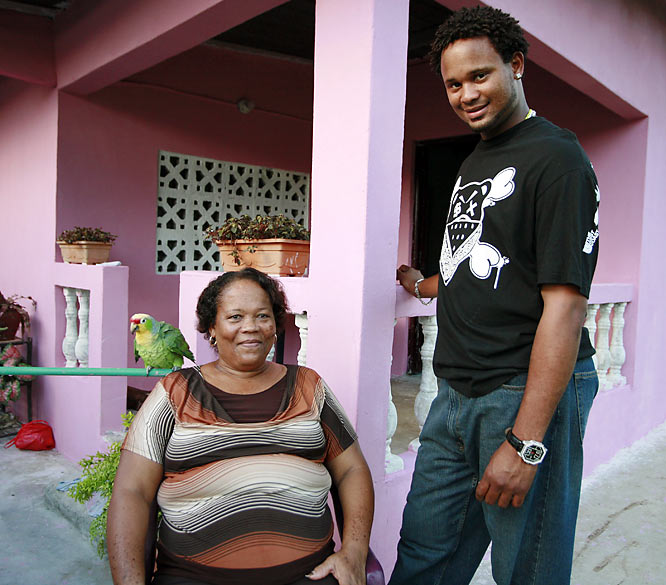 Colorado Rockies pitcher Manny Corpas and his mother, Florenica Gil de Corpas, pose in his childhood neighborhood of Chilibre, Panama.