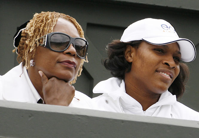 Serena Williams and her mom, Oracene, watch  Venus compete at Wimbledon in 2007.