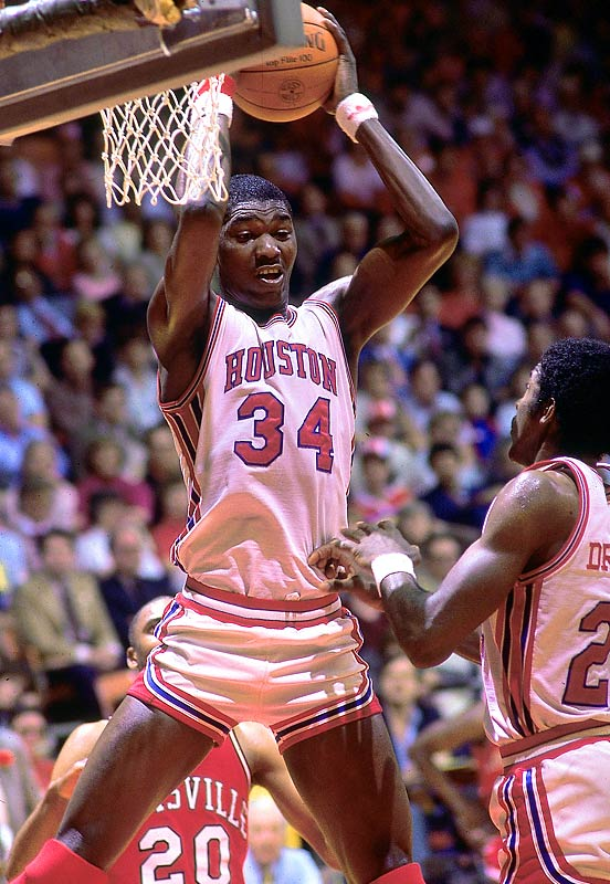 Hakeem Olajuwon emigrated from Nigeria to play under Guy Lewis at the University of Houston despite never playing basketball until the age of 15. After red-shirting as a freshman, the seven-footer teamed with Clyde Drexler to lead the Cougars to three consecutive Final Fours, including appearances in the 1983 and 1984 title games. Olajuwon's Houston teams went by the semi-official nickname Phi Slama Jama, a tribute to their fast-breaking style and explosive slam dunks.