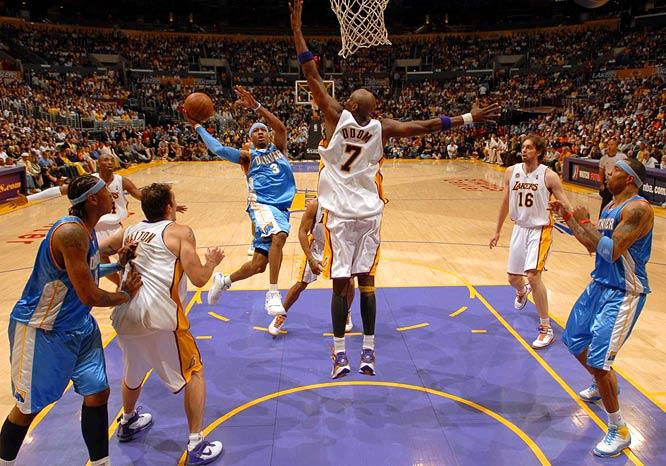 Denver's Allen Iverson goes up for a shot against Lamar Odom.
