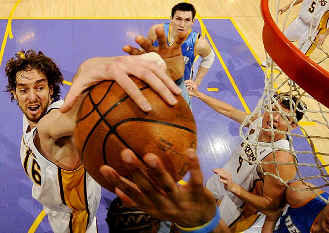 Pau Gasol of the Lakers goes up for a block during L.A.'s game against the Nuggets.