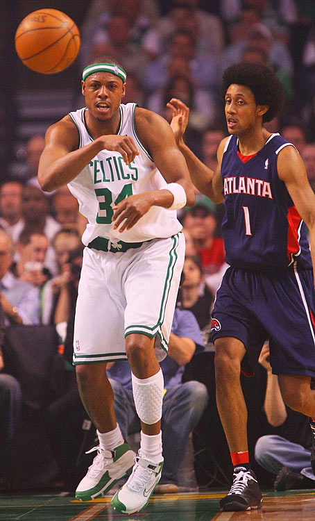 Boston's Paul Pierce makes a pass as Atlanta's Josh Childress watches.