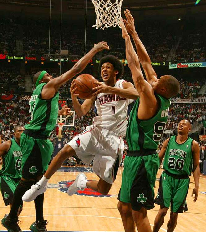 Hawks guard Josh Childress slices through Celtics' defenders James Posey (left) and P.J. Brown during Game 3.  Childress scored six points off the bench as the Hawks won 102-93.