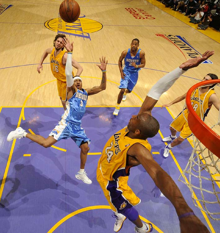 Allen Iverson shoots over Kobe Bryant during Game 2 of their first-round series.  Iverson had 31 points and six assists to lead the Nuggets.
