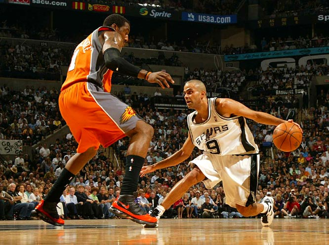 Spurs point guard Tony Parker attempts to drive around Amare Stoudemire during Game 2 of the Spurs-Suns first round series.  The Suns gave away a double-digit, first-half lead, and Parker scored 32 points to lead the Spurs to a 102-96 victory.
