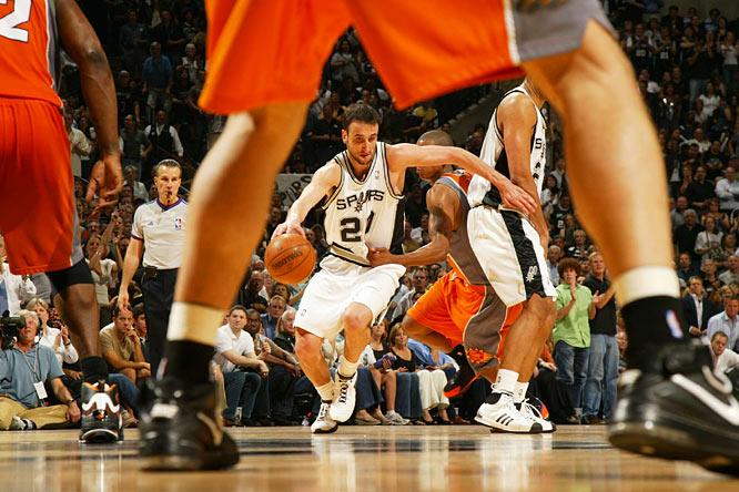 Spurs guard Manu Ginobili dribbles through traffic during Game 2. Ginobili, who won the NBA's sixth man award, scored 29 points for San Antonio.