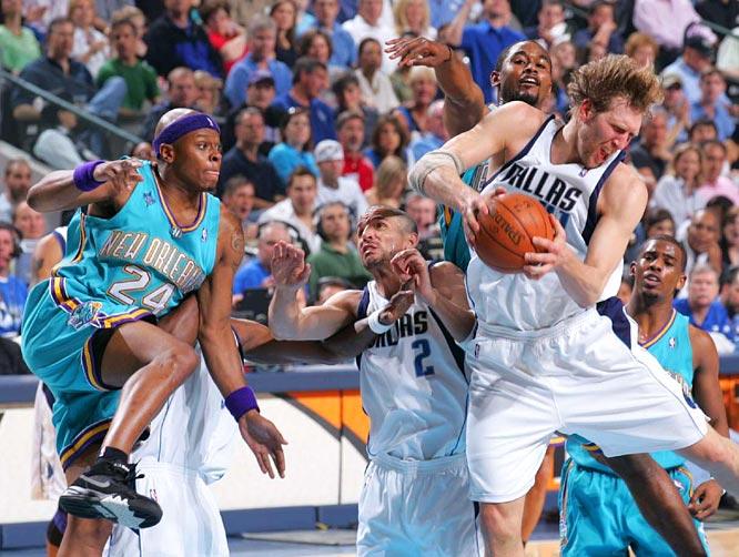 Dirk Nowitzki snares one of his 19 rebounds in Game 3.