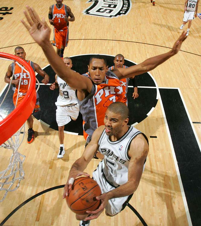 San Antonio's Ime Udoka gets around Boris Diaw  during Game 2 of their first round series. Udoka finished with six points.