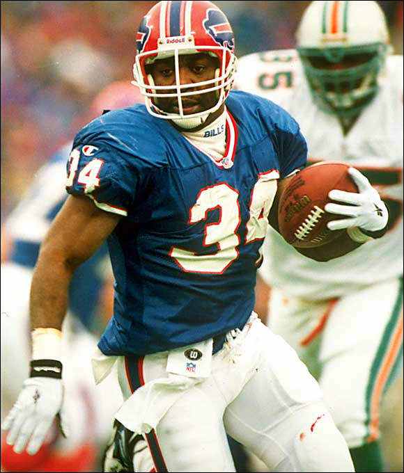 Thanks to a serious knee injury he suffered at Oklahoma State, Thomas slipped to the Bills in the second round. He instantly energized Buffalo's offense and helped form a nucleus that carried the Bills to four straight Super Bowls. He retired in 2001 ranked sixth all time in total yards from scrimmage (16,532) and ninth in rushing (12,074). Thomas said the anger he felt at being bypassed in the first round was a key motivating factor in his rise to stardom.
