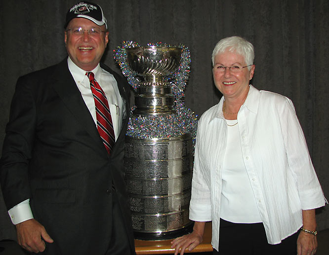 """Harvey Schmitt, who helped recruit the Carolina Hurricanes to Raleigh in 1997, was thrilled when the `Canes won the Cup in 2006. """"My wife Pam joined me for a photo and with a last minute burst of creativity we hastily scrounged around to find some tinsel to put in the Cup and used the photo as our Christmas Card."""""""